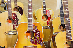 Collection of electric guitars at music store Royalty Free Stock Photos