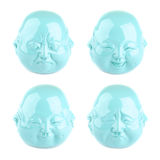 Collection of emotions. Four views of turquoise head statuette Stock Images