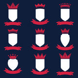 Collection of empire design elements. Heraldic royal coronet ill. Ustration. Set of luxury vector shields with king crown and undulate festive ribbon Stock Images