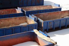 Collection of empty blue containers in winter Royalty Free Stock Photo