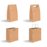 Collection of empty brown paper bag with handles. Realistic kraft package with shadows  on white background. Set. Of design templates Royalty Free Stock Photos