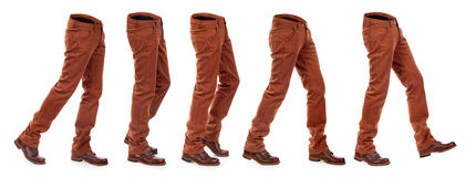 Collection of empty jeans in motion with shoes Stock Image
