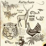 Collection of engraved hand drawn elements hunting season design Stock Images