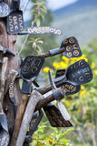 A collection of engraved tools hang in a tree in Cayambe in Ecuador in South America. The tools were on display at the Middle of the World theme park royalty free stock photos