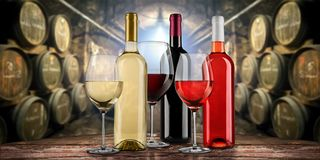 Collection of equisite red white and rose wine bottle glasseson wooden table in front of old rustic winery cellar background. Collection of equisite red white stock image
