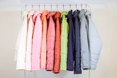 A collection of fashionable autumn jackets on hangers in shop. Royalty Free Stock Photography