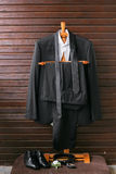 Collection of fashionable business clothes for men. The discreet black suit tie, shirt, leather shoes Stock Image