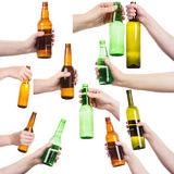Collection of female hands holding bottles of alcohol Royalty Free Stock Photo