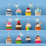 Collection of festive cupcakes with sparklers and candles. Collection of mouth-watering festive cupcakes with sparklers and candles. Realistic style Stock Photo