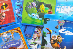 A collection of films by Disney Pixar Animation Studios on Blu-ray. BARCELONA, SPAIN - APR 18, 2014: A collection of films by Disney Pixar Animation Studios on Stock Images