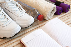 Collection fitness accessories, dumbbells, running shoes,  training Royalty Free Stock Photo