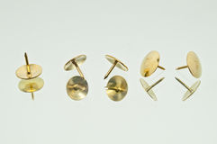 A Collection of Five Lying Thumbtacks Stock Images