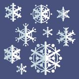 Collection of flat style vector snowflakes. Set of winter icons. Stock Images