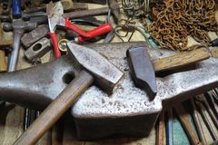 Collection of flea market old farrier working tools Royalty Free Stock Photo