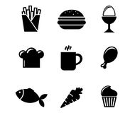 Collection of food icons. Collection of black and white silhouette food icons including French fries, boiled egg, toque, cookie, coffee, drumstick, fish, carrot Stock Photography