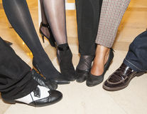 Collection of footwear on peoples feet Stock Photo