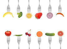 Collection of forks with vegetables and fruits Royalty Free Stock Photography