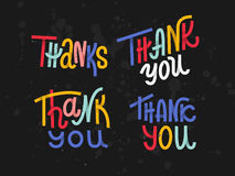 Collection of four custom colorful pieces of Thank you lettering Stock Images
