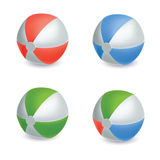 Collection of four different colored beach balls. Stock Photography