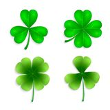 Set of green clover leaves isolated on white background. Collection of four-leaf clovers. Clover leaves set - quarterfoil and trefoil. Vector set of green clover