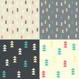 Collection of four seamless patterns with geometric triangles Royalty Free Stock Photo