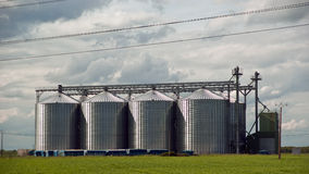 Collection of four shiny new grain bins Royalty Free Stock Images