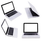 Collection of four silver laptops Stock Photography