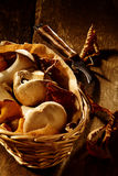 Collection of fresh autumn fungi in a basket Royalty Free Stock Photo