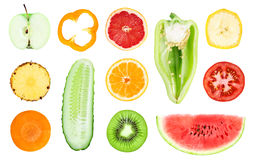 Collection of fresh fruit and vegetable slices. On white background Royalty Free Stock Photography