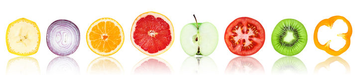 Collection of fresh fruit and vegetable slices. On white background Stock Photos