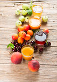 Collection of fresh fruits and juices Stock Photos