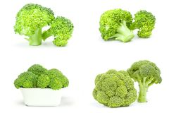 Group of fresh raw broccoli isolated on a white cutout. Collection of fresh green broccoli isolated over a white background Royalty Free Stock Photography