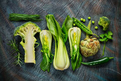 Collection of fresh green vegetables on black stone Royalty Free Stock Photos