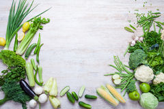 Collection of fresh green vegetables on white rustic background. Collection of fresh green vegetables on white rustic background, lettuce, celery, beans royalty free stock photo