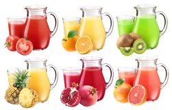 Collection of fresh juices in pitchers. Royalty Free Stock Photography