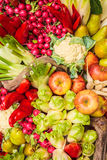 Collection of fresh organic food. With apples, bell peppers and other vegetables Stock Photography