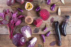 Collection of fresh purple fruit and vegetables on wooden background. Collection of fresh purple fruit and vegetables on wooden background Royalty Free Stock Photos
