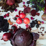 Collection of Fresh Purple Fruits and Vegetables. Such as Plums, Beetroots, Onions, Aubergine, Lettuce, Cabbage, Beans, Figs, Grapes on the White Background Stock Images