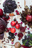 Collection of Fresh Purple Fruits and Vegetables. Such as Plums, Beetroots, Onions, Aubergine, Lettuce, Cabbage, Beans, Figs, Grapes on the White Background Stock Photo