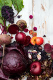 Collection of Fresh Purple Fruits and Vegetables. Such as Plums, Beetroots, Onions, Aubergine, Lettuce, Cabbage, Beans, Figs, Grapes on the White Background Stock Image