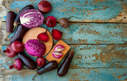 Collection of fresh purple vegetables on the blue wooden backgro. Und with top view  ready for your design Royalty Free Stock Image