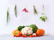 Collection of fresh vegetables on a white wooden table. Royalty Free Stock Photos