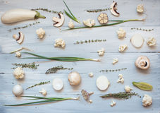 Collection of fresh white green toned vegetables raw on wood rustic background. Stock Images