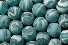 Frosted Blue Marbles. A collection of frosted blue and white swirl marbles Stock Photo