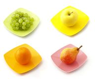 The collection of fruits. On the dishes Royalty Free Stock Photo