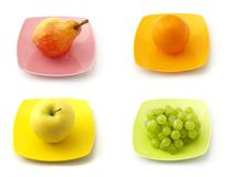 The collection of fruits. On the dishes Royalty Free Stock Image
