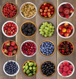 Collection of fruits and berries in a bowl. Top view. Collage of fruits and berries. Blueberries, blackberries, cherries, grapes, strawberries, currants Stock Image
