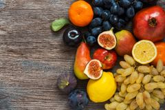 A collection of fruits on a wooden surface, top view. royalty free stock photo