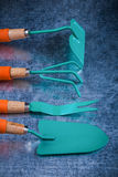 Collection of gardening tools on scratched metallic surface vertical Royalty Free Stock Image