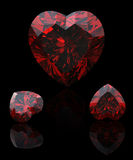 Collection garnet shape of heart  on black Stock Photography